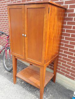 World Market T.V. cabinet, or storage /Bookshelf. includes one shelf. for Sale in Denver,  CO