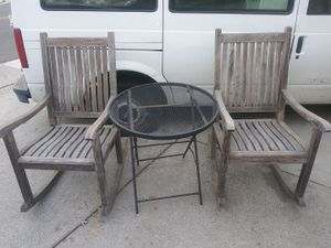 Brazillian Iron Wood outdoor patio rocking chairs and metal table for Sale in Walnut Creek, CA