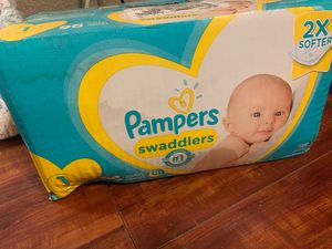 Size 1 96 10 dollars newborn 3 packs of 28 15 dollars and a pack of 30 diapers of size 3 for Sale in Perris, CA