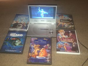DVD Player + Walt Disney Classic Movies for Sale in Austin, TX