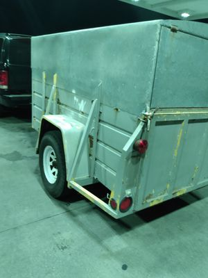 5x8 Utility trailer. 15in good tires plus spare .Tailgate locks. All steel . Roof is galvanised metal. Will fit in garage .Steel frame under roof. for Sale in NEW PRT RCHY, FL