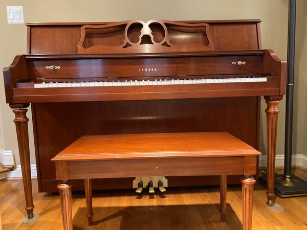 Yamaha upright piano and bench, approximately five years old in like new condition. Moving and must sale.