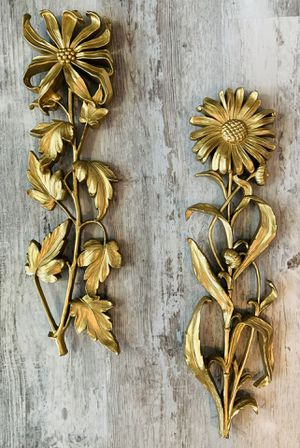 Set of 2 Vintage 1966 Syroco gold floral wall hangings. Made i the USA. They each have a sturdy metal hanger on the back and can be hung together as for Sale in Tacoma, WA