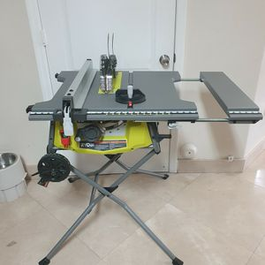 "RYOBI 10"" EXPANDED CAPACITY TABLE SAW W/ ROLLING STAND (#11) for Sale in Miami, FL"