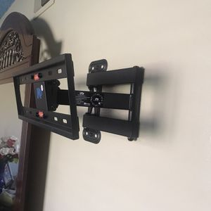 25to 60inch Tv Wall Mounting Stand Perfect Condition One Month Old for Sale in Chino, CA