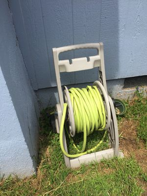 Garden Hose with roller holder 100ft for Sale in San Diego, CA