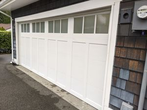 Used garage door fits 16' wide x 7' tall opening for Sale in Seattle, WA