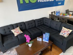 Black sectional couch was $899 now $699 for Sale in Banning, CA