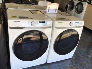 Samsung front load washer and electric dryer in white for Sale in Fresno, CA
