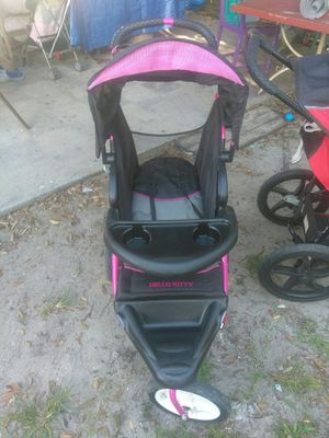 Hello Kitty jogging stroller for Sale in Wahneta, FL