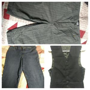 Vans shorts size 36, size 12 petite Lee's jeans, and a vest for Sale in Brownstown, IN