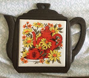 Teapot trivet cast iron and ceramic pot holder for Sale in Rancho Cucamonga, CA