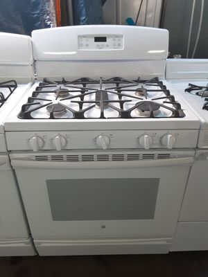 350 dollar GE 5 burner white gas stove includes delivering the San Fernando Valley a warranty and installation for Sale in Los Angeles, CA