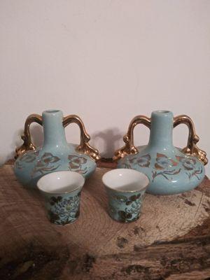 Powder blue bottles vases cups tea flowers gold handles ewers for Sale in Clarksville, TN