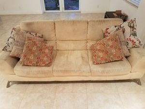 Contemporary real suede 8 ft couch with 6 pillows as shown for Sale in Oakland Park, FL
