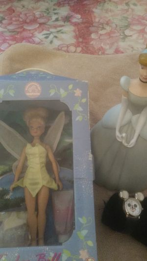 A collector's Vault Disney doll a Walt Disney piggy bank Walt Disney watch girls watch for Sale in La Puente, CA