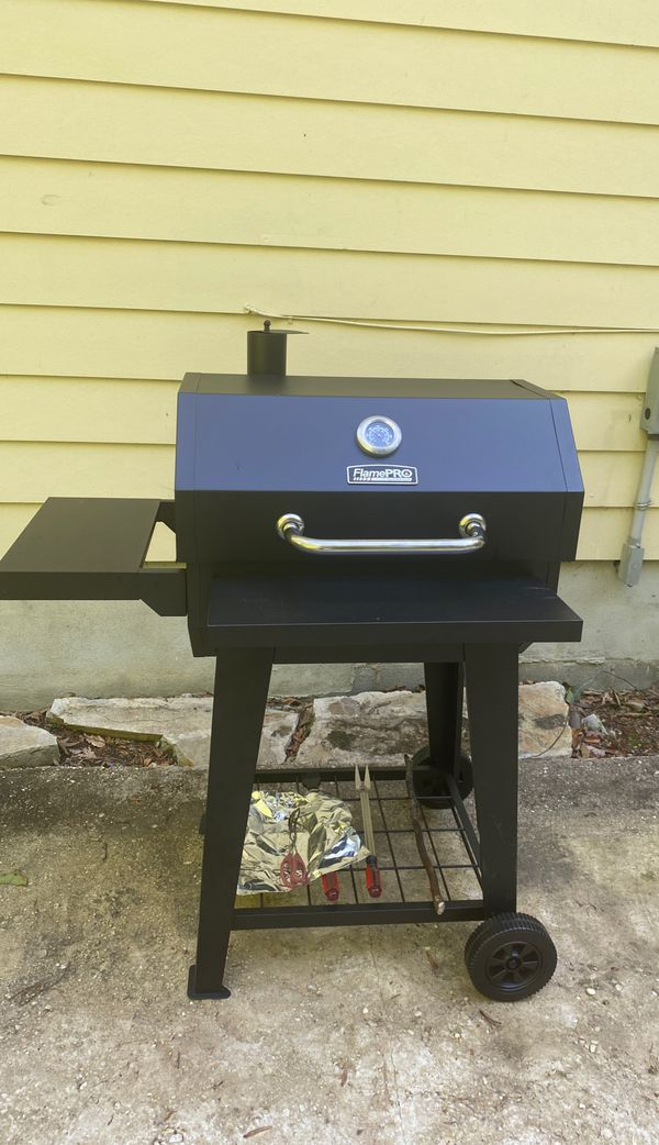 New charcoal grille already assembled for convenience