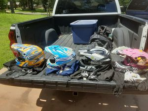 Yellow-adult. Other 3 are kids. $50.00 per helmet for Sale in Henderson, TX