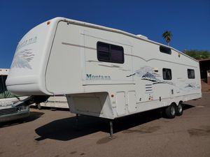2003 Keystone Montana 3655FL w/ Generator and Solar Panels 5th wheel Travel Trailer for Sale in Mesa, AZ