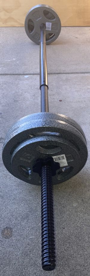 Weights 4x10lb and 2x5lb Standard 1 inch plates with a straight bar for Sale in Covina, CA