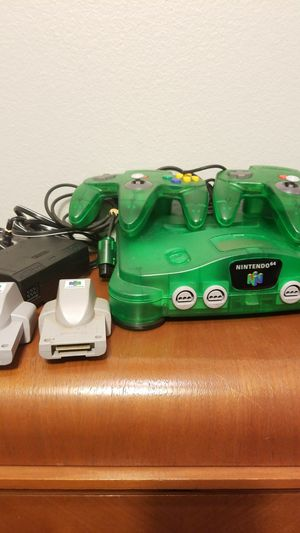 Nintendo 64 Jungle Green Console with 2 Original Controllers 2 Rumble Packs for Sale in Huntington Beach, CA