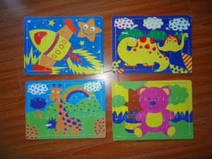 4 WOODEN PUZZLES TOYS FOR KIDS WITH STORAGE CASE. DINOSAUR, GIRAFFE, TEDDY BEAR, ROCKET. 2-5 YO. for Sale in West Hollywood, CA