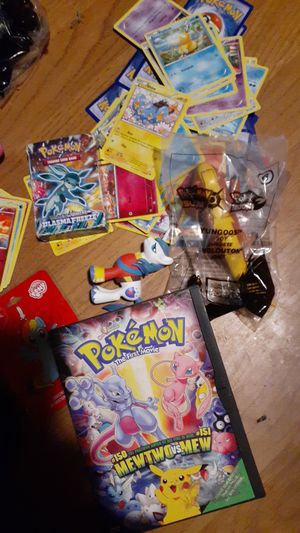 Cans of Pokemon cards figurines pendants Exedra would like to sell for Sale in Liberty, SC