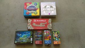 Four puzzles and three board games for Sale in Maricopa, AZ