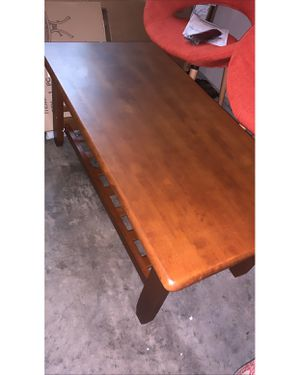 Coffee table New has a small chip on the end as you can see in the pictures Color cherry! for Sale in Murfreesboro, TN
