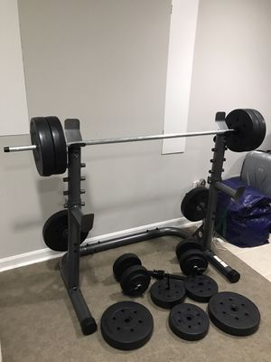 Squat Rack with Adjustable Safety Spotters Bar Holds new and 6ft barbell 230lbs weight plate for Sale in NO POTOMAC, MD