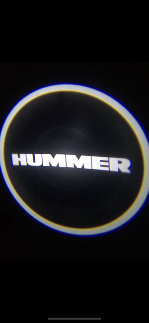 Hummer car door projector lights shadow lights auto on/off aaa batteries for Sale in Long Beach, CA