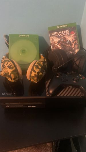 Xbox one with two games two headsets and a controller for Sale in Anaheim, CA