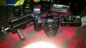 Lot of cameras 1 vintage Minolta film camera 1 Bell & Howell in 1 nikon also accessories and one Kodak disc camera for Sale in Tallahassee, FL