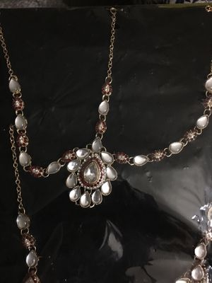 ForHead jewelry and long earring with chain goes on the sides with pin in your hai. Beautiful charming. You will make your evening and night bright a for Sale in Fort Washington, MD