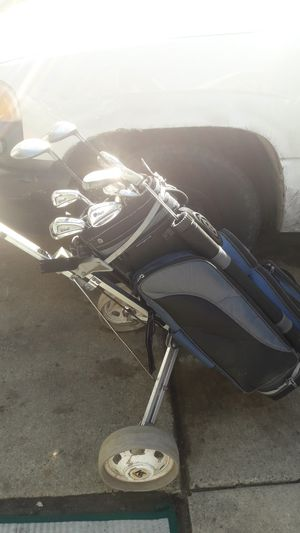 Golf clubs golf bag golf bag carrier for Sale in Detroit, MI