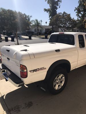 "Tacoma or small truck TONNEAU cover fiberglass three door lockable A RE brand cover camper shell 60"" x 75"" Ontario 91762 for Sale in Chino, CA"