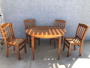 Solid wood fold down dining room table and chair set for Sale in Norwalk, CA