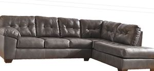 L shaped leather black couch leather ottoman included for Sale in Silver Spring, MD