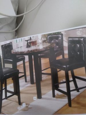 Counter height dining table with 4 stools. Marble top for Sale in Atlanta, GA