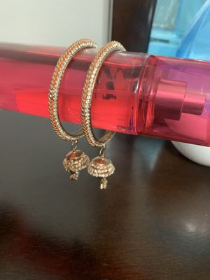 Bangles Rose color with charms hanging as shown pictures for Sale in Silver Spring, MD
