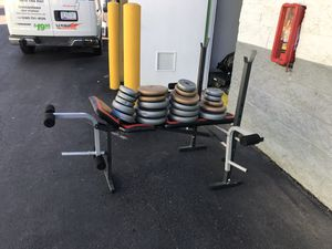 Weight bench with lots of free weights. for Sale in Germantown, MD