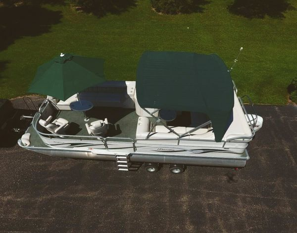 2006 Manitou Legacy Pontoon Boat and Trailer