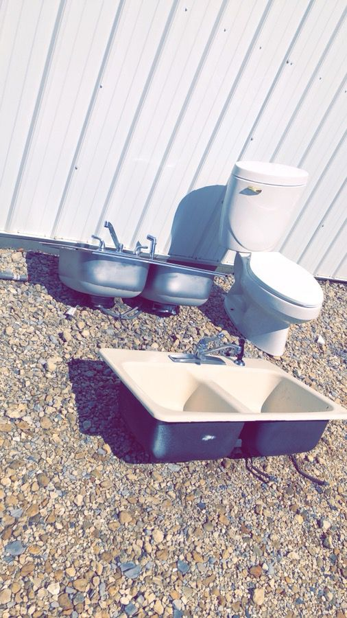 Multiple kitchen sinks and toilets