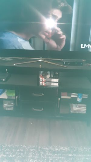 Black TV has two deep drawers two glass doors plenty of shelf room for Sale in Columbus, OH