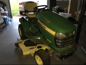John Deere X340 Riding Lawn Mower (Willing to negotiate price) for Sale in Marietta, GA