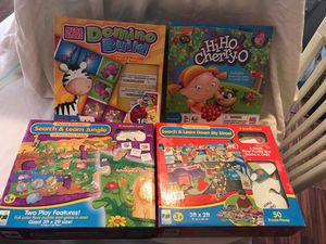 Hi-Ho Cheerio Game and Domino Mega Block and 2 giant floor puzzles. for Sale in Phoenix, AZ