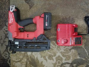 Practically brandnew millwaukee trim gun. With a bigger battery and new charger. for Sale in San Antonio, TX