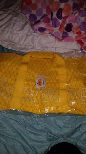 Yellow supreme duffle bag for Sale in Hutto, TX