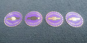 CHEVY BOWTIE WIRE WHEEL SPOKE RIM KNOCK OFF GOLD LILAC PURPLE SPINNER CHIP INSERT SET SIZE 2.38 LOWRIDER for Sale in Chicago, IL