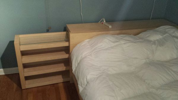 IKEA queen size bed with roll out shelves